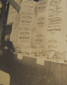 Brother Alphonse Juin with advertisements for Oka cheese
